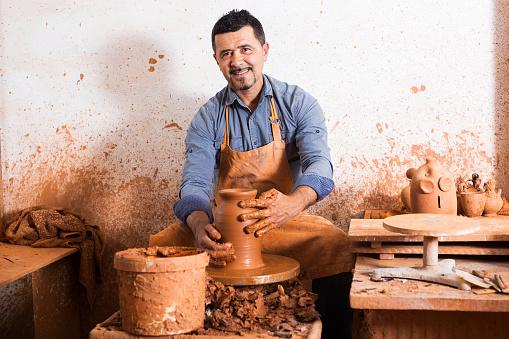 Mature man making pot
