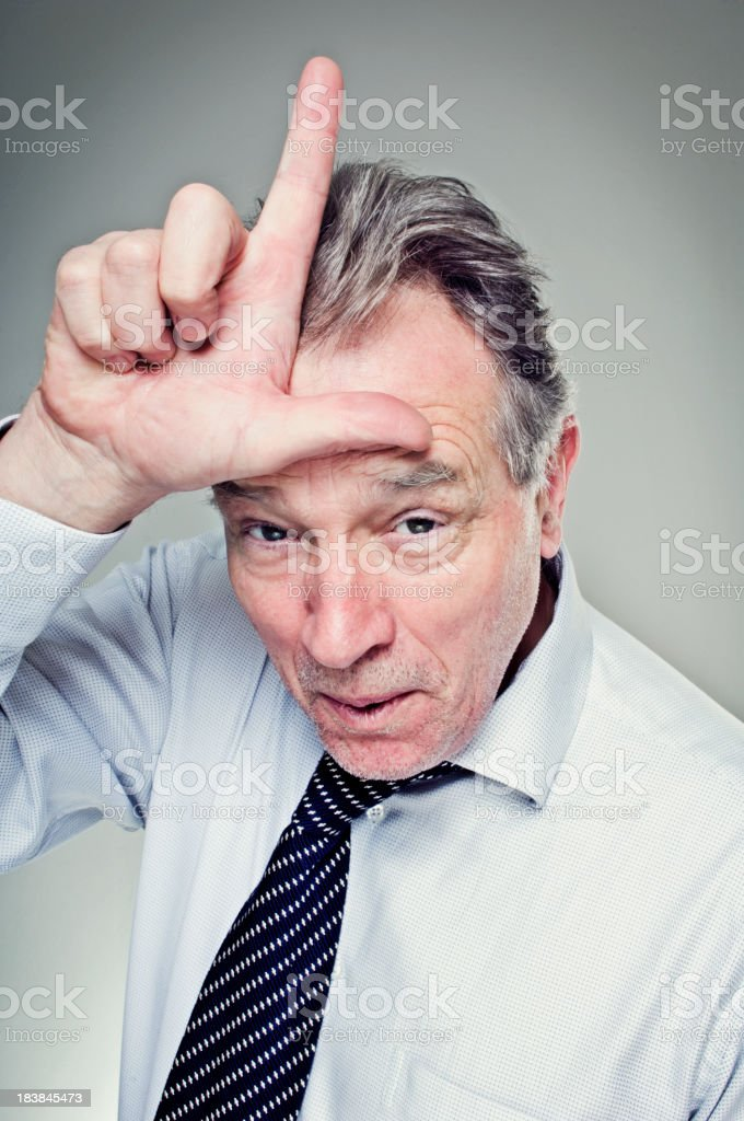 Mature Man Making the 'L' for Loser Sign stock photo