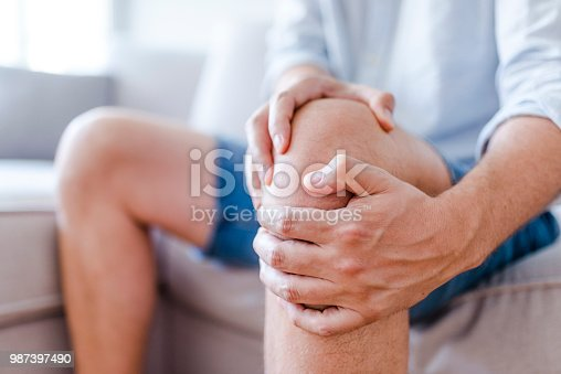 istock A mature man massaging his painful knee 987397490