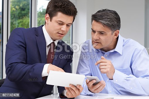istock Mature Man Meeting With Financial Advisor At Home 621142428
