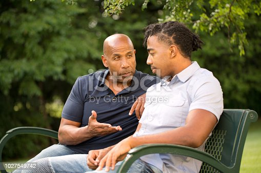 istock Mature man mentoring and giving advice to a younger man. 1027549742