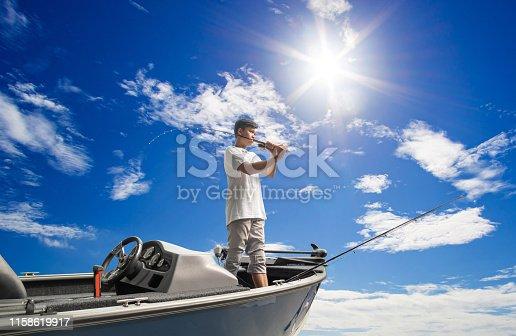 156872766istockphoto Mature man on a motor boat. Fishing 1158619917