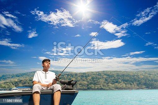 156872766istockphoto Mature man on a motor boat. Fishing 1158619955