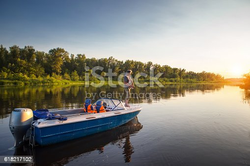 Mature man on a motor boat. Fishing.