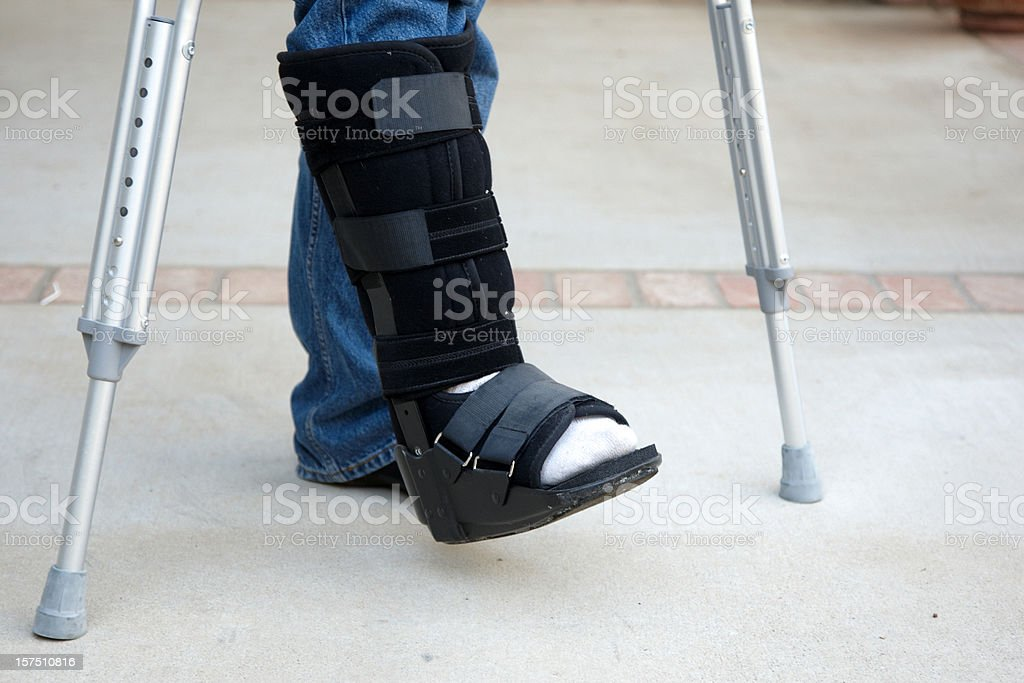 Mature man on crutches stock photo