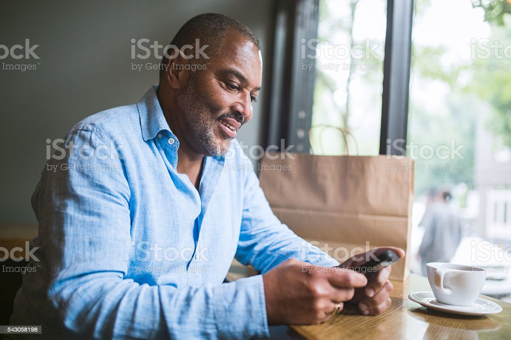 Mature Man on Smart Phone stock photo