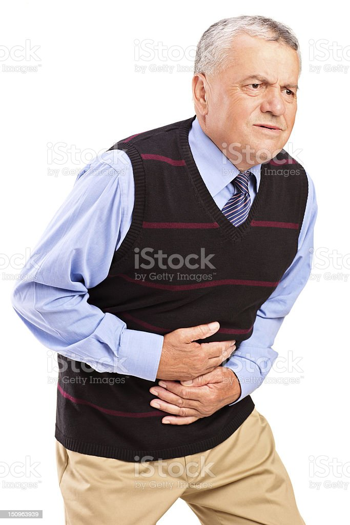 Mature man overwhelmed with a pain in the stomach stock photo
