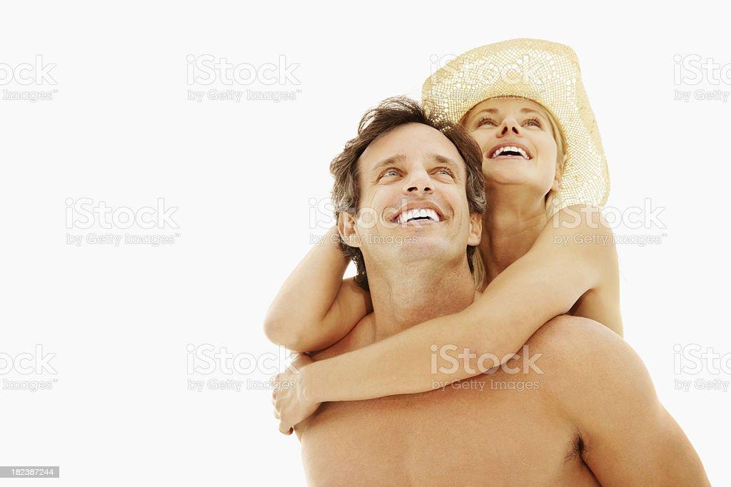 Mature man piggybacking his wife royalty-free stock photo