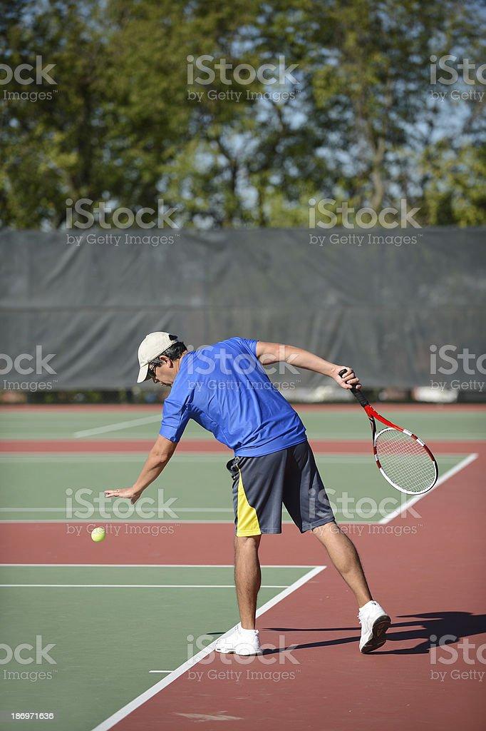 Mature Man Playing Tennis stock photo
