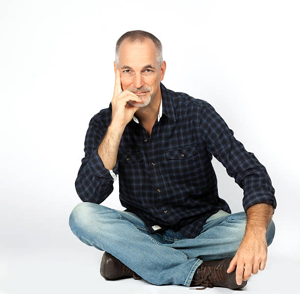 mature man portrait - sitting on floor stock photos and pictures