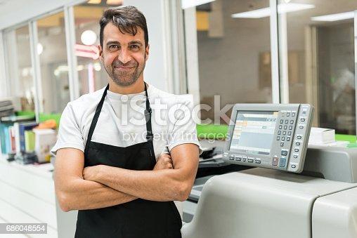 istock Mature man posing at his printing-graphic design shop 686048554