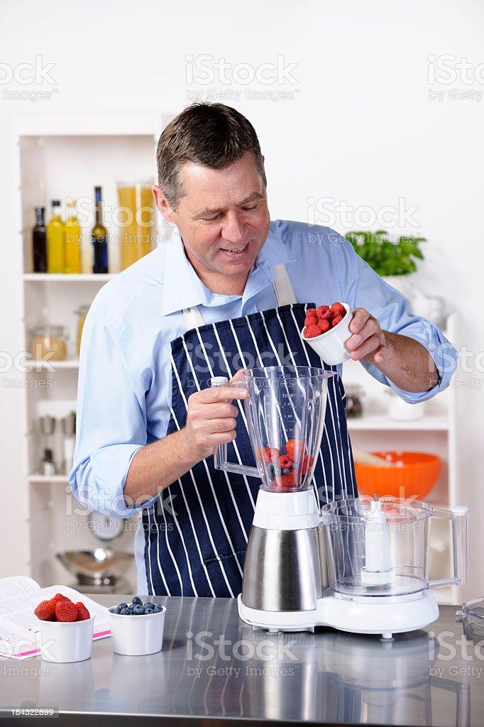 Mature Man Preparing A Healthy Drink/ Dessert royalty-free stock photo