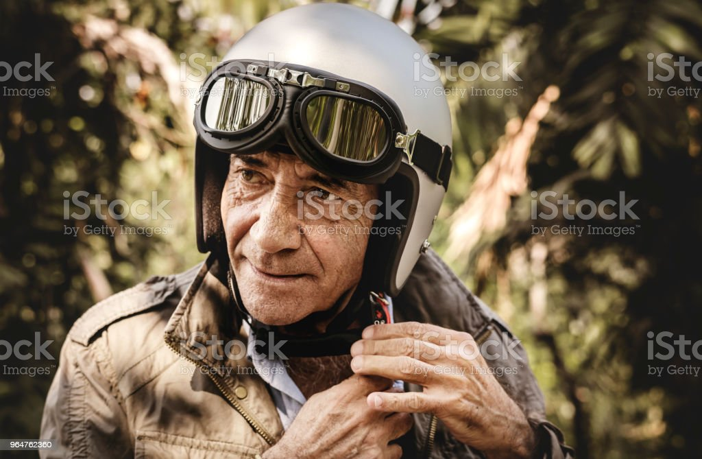 Mature man putting on a helmet royalty-free stock photo