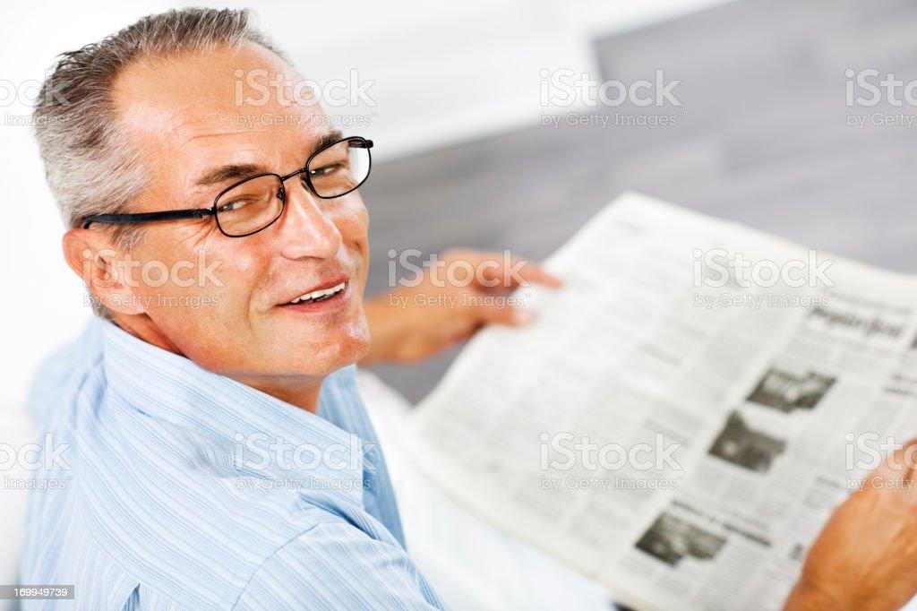 Mature man reading newspaper royalty-free stock photo