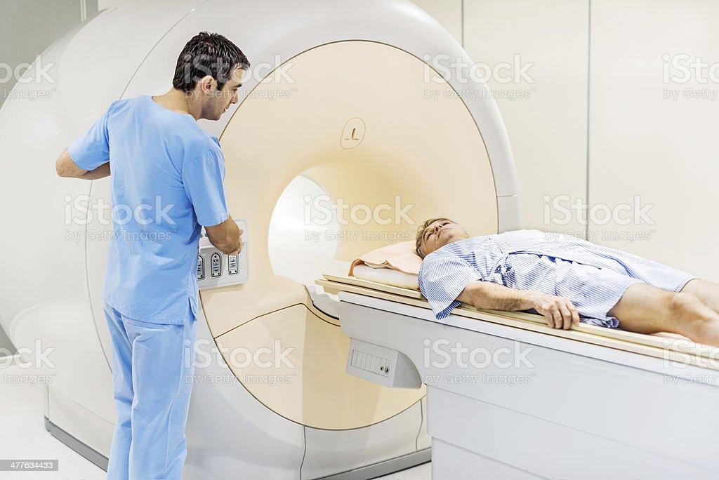 Mature man receiving an MRI Scan. stock photo