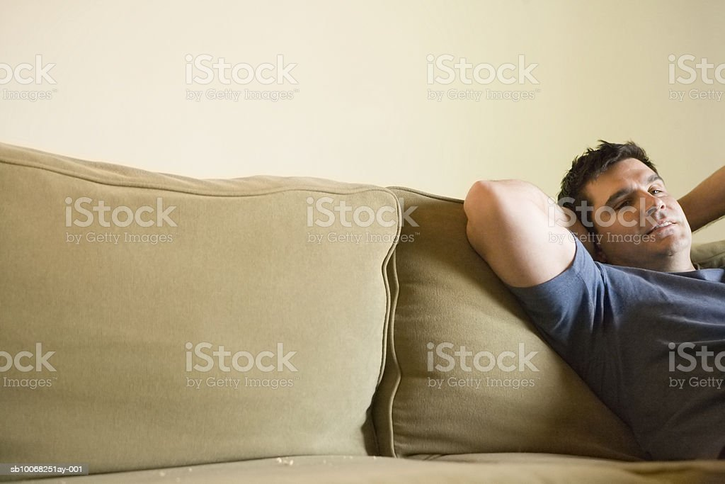 Mature man relaxing on sofa royalty-free stock photo