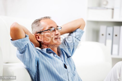 530281733istockphoto Mature man resting at home. 170171835