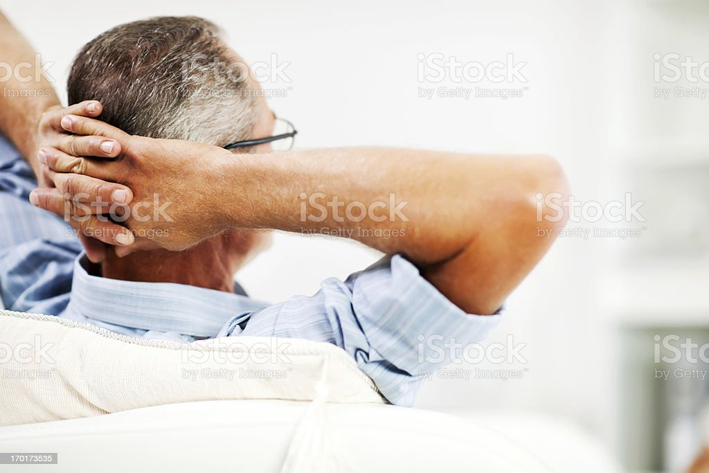 Mature man resting on sofa royalty-free stock photo