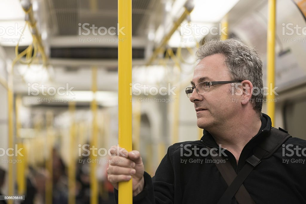 Mature Man Riding the Train - London Underground royalty-free stock photo
