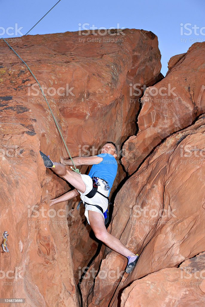 Mature Man Rock Climbing royalty-free stock photo