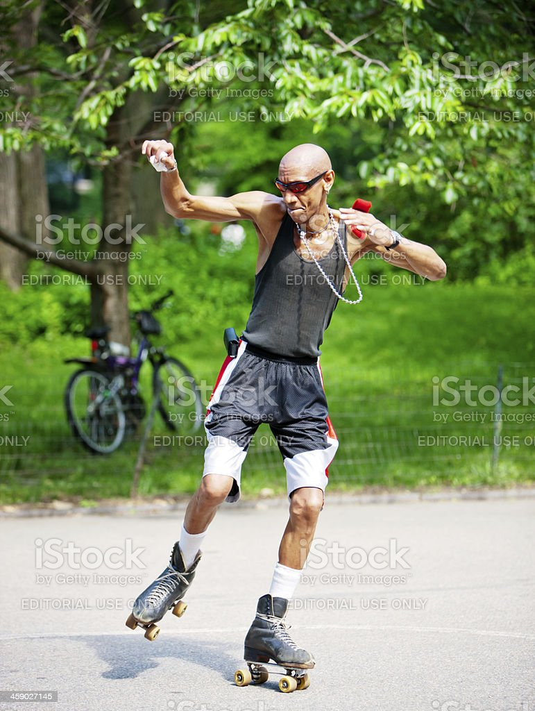 Mature Man Roller-skating in Central Park, New York royalty-free stock photo