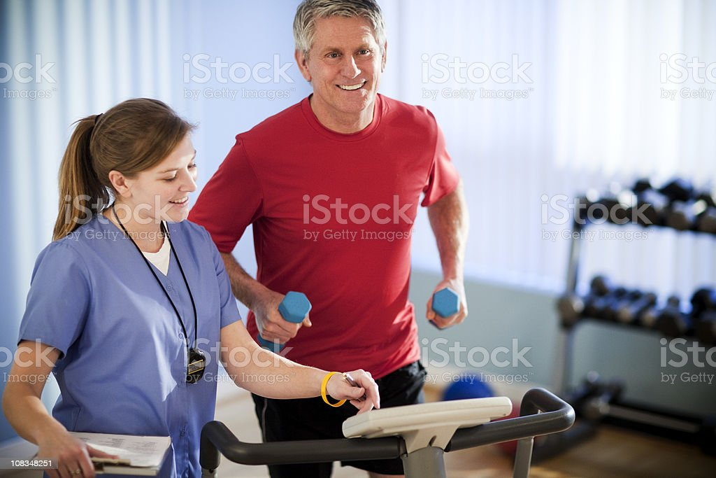Mature Man Running With Dumbbells for Physical Therapy royalty-free stock photo