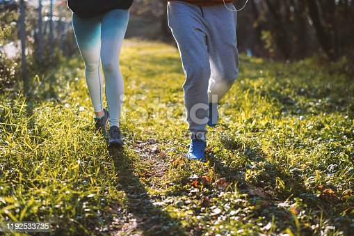 Mature man running with his personal coach