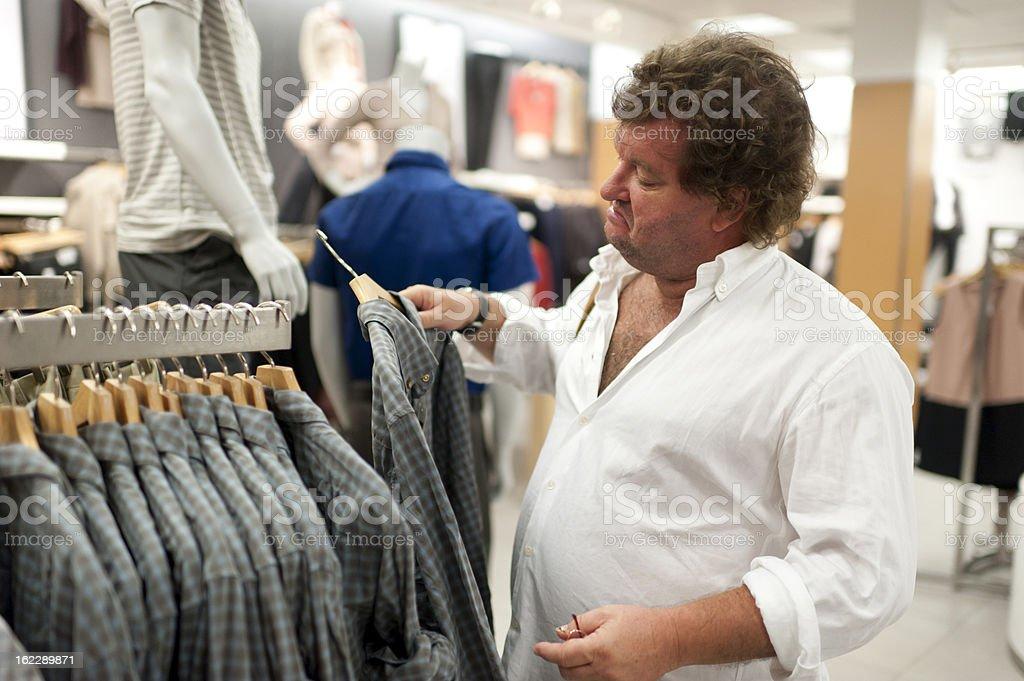 Mature man shopping for a shirt stock photo
