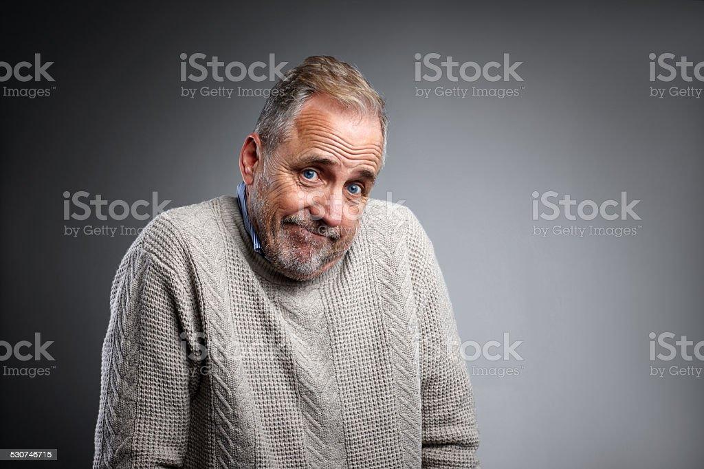 Mature man shrugging stock photo