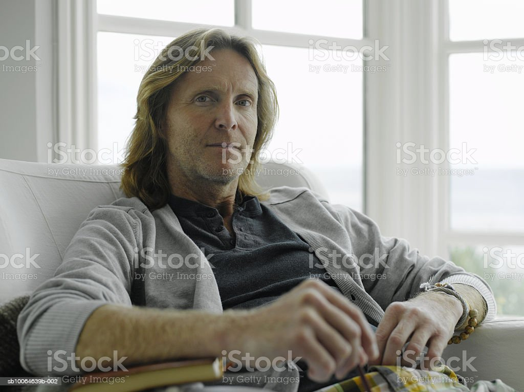 Mature man sitting on arm chair, portrait royalty-free stock photo