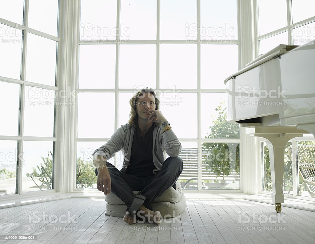 Mature man sitting on chair, portrait 免版稅 stock photo