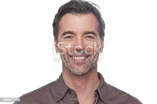 637538262istockphoto Mature Man Smiling At The Camera Isolated On White 483917798
