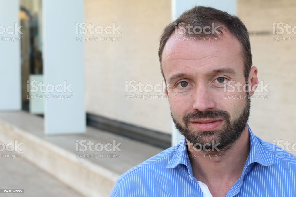 Mature man smiling isolated outdoors stock photo
