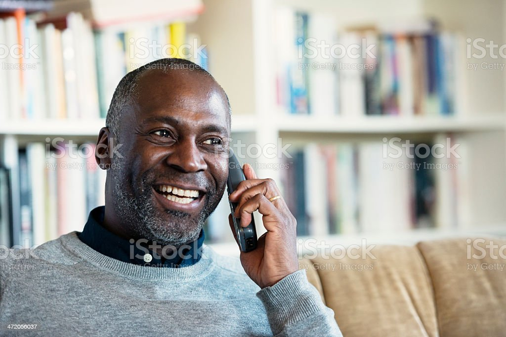 Mature Man smiling while on a telephone stock photo