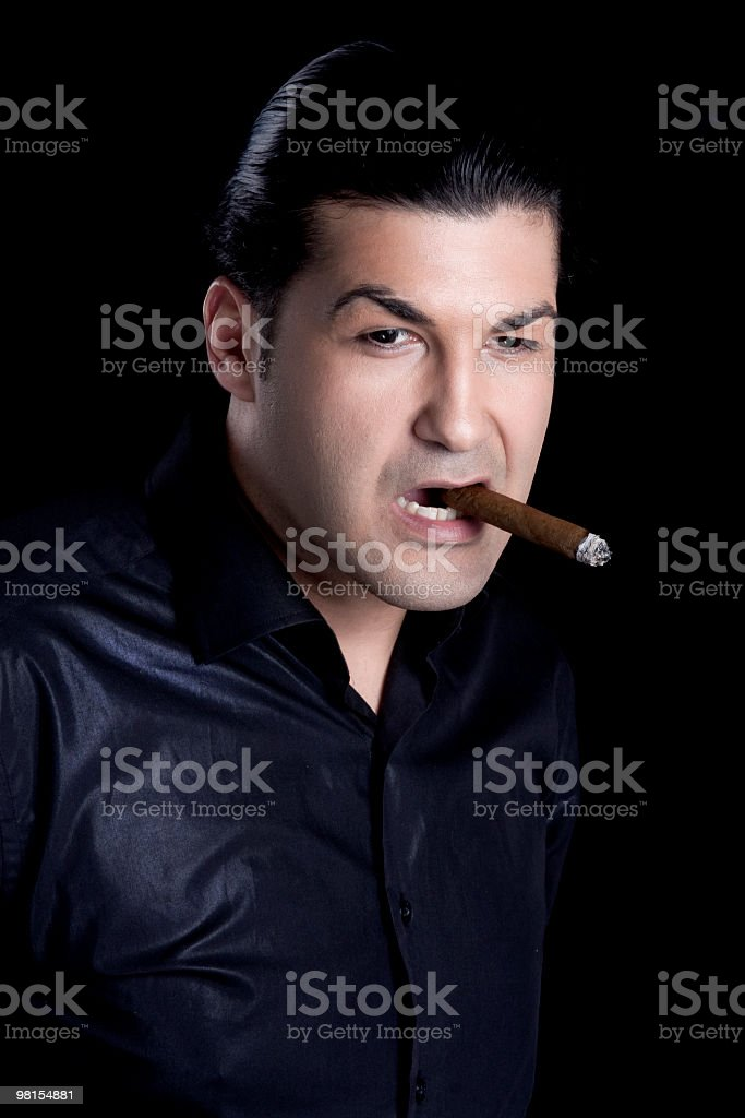 Uomo maturo fumare Sigaro foto stock royalty-free