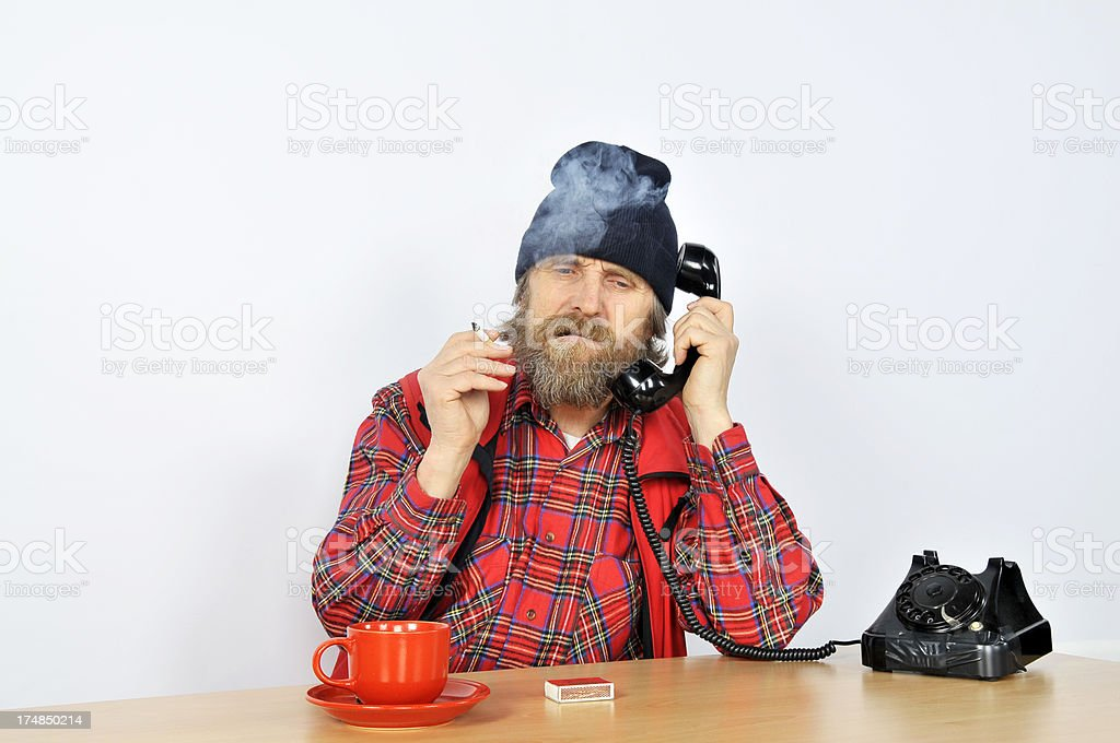 Mature Man Smoking while Phoning royalty-free stock photo