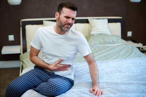 Mature man suffering from a stomachache stock photo