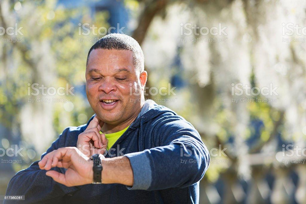 Mature man taking pulse stock photo