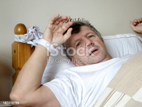 Mature man tied to bedpost.