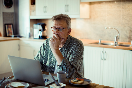 Mature Man Using A Laptop Stock Photo - Download Image Now