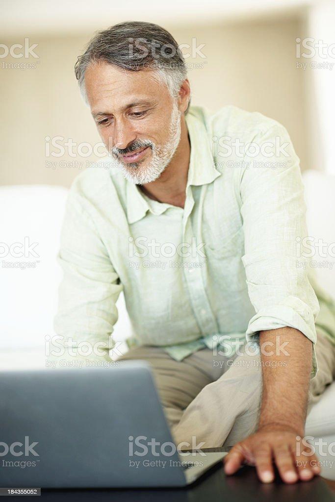 Mature man using laptop royalty-free stock photo