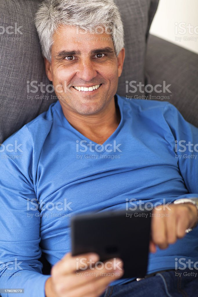 mature man using tablet computer stock photo