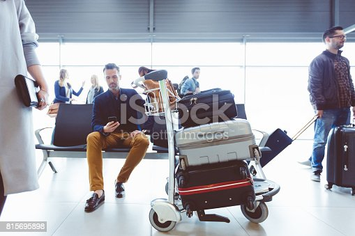 istock Mature man waiting at airport lounge 815695898