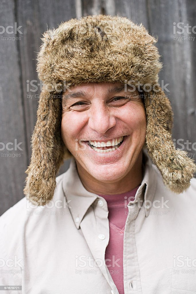 Mature man wearing fur hat stock photo