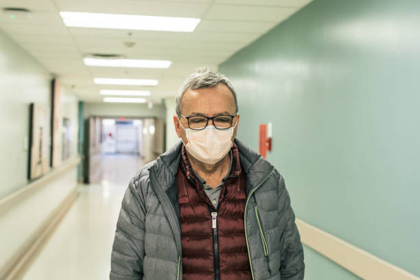 Mature Man With a Face Mask at the Hospital stock photo