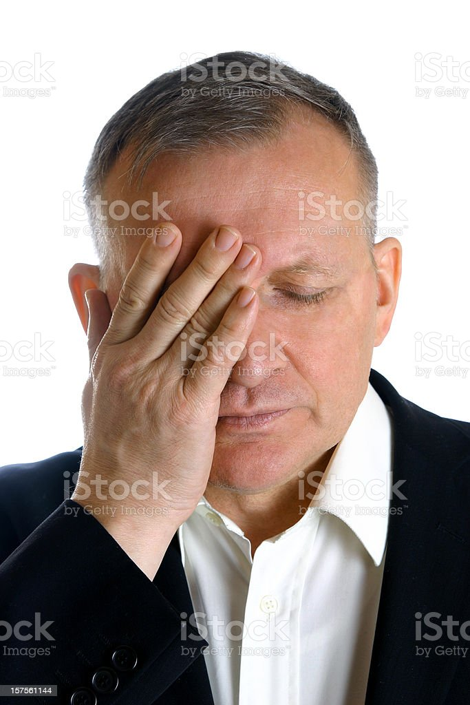 Mature man with a headache stock photo