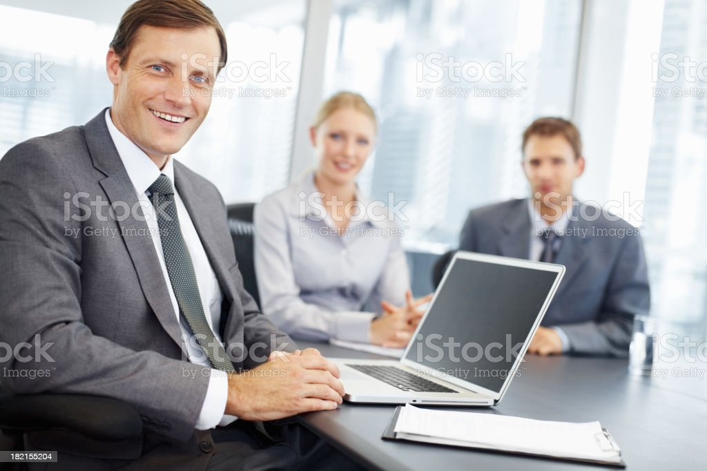 Mature man with colleagues during business meeting royalty-free stock photo