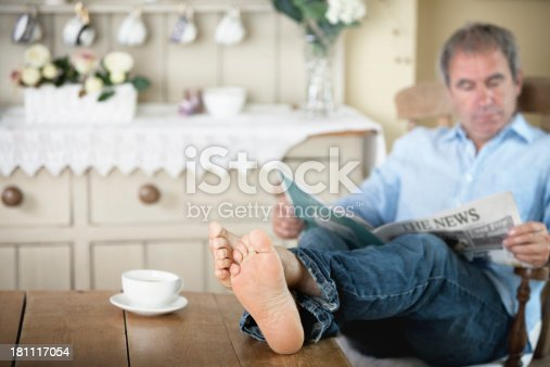 Mature Man With Feet Up Reading Newspaper Stock Photo  More Pictures Of 40-49 Years -2533