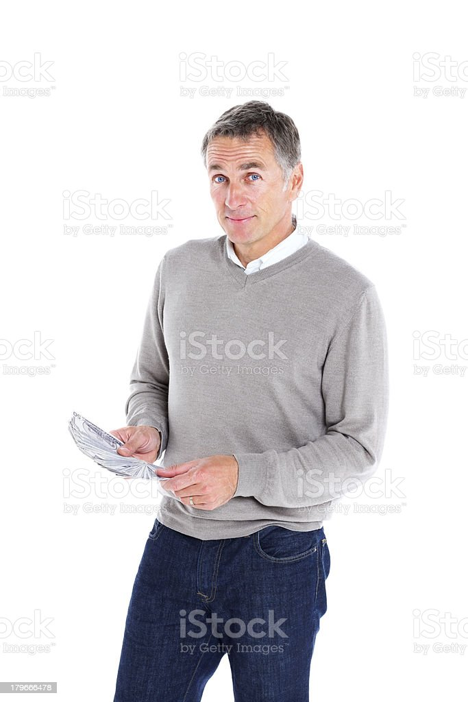 Mature man with fifty dollar notes stock photo