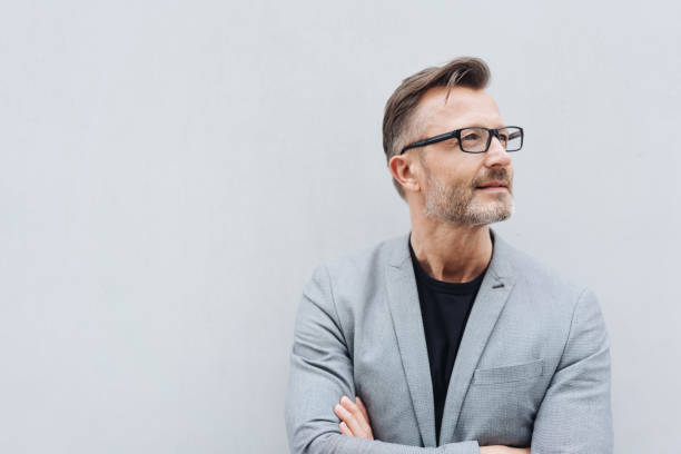 Mature man with glasses wearing grey jacket stock photo